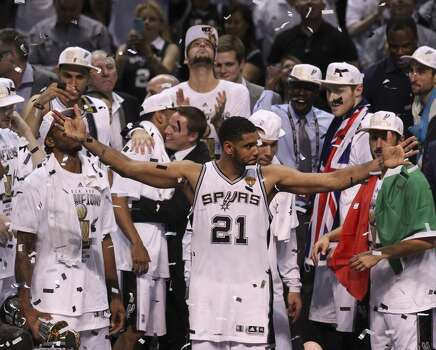 San Antonio Spurs' Tim Duncan acknowledges the fans after winning Game 5 against the Miami Heat at the 2014 NBA Finals at the AT&T Center on Sunday, June 15, 2014. (Kin Man Hui/San Antonio Express-News) Photo: Kin Man Hui, San Antonio Express-News