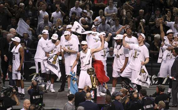 San Antonio Spurs' Manu Ginobili waves a towel to spur the crowd after the Spurs win Game 5 against the Miami Heat at the 2014 NBA Finals at the AT&T Center on Sunday, June 15, 2014. (Kin Man Hui/San Antonio Express-News) Photo: Kin Man Hui, San Antonio Express-News