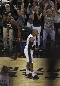 San Antonio Spurs' Patty Mills reacts after hitting a three pointer  against the Miami Heat in the second half of Game 5 of the 2014 NBA Finals at the AT&T Center on Sunday, June 15, 2014. (Kin Man Hui/San Antonio Express-News) Photo: Kin Man Hui, San Antonio Express-News