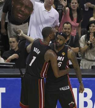 Miami Heat's LeBron James gets a hug from teammate Miami Heat's Chris Bosh in the closing moments of Game 5 as the Heat go down to the San Antonio Spurs in the 2014 NBA Finals at the AT&T Center on Sunday, June 15, 2014. (Kin Man Hui/San Antonio Express-News) Photo: Kin Man Hui, San Antonio Express-News