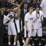 San Antonio Spurs' Manu Ginobili receives a hug from Tim Duncan in the closing moments of Game 5 as the Spurs defeat the Miami Heat in the 2014 NBA Finals at the AT&T Center on Sunday, June 15, 2014. (Kin Man Hui/San Antonio Express-News)