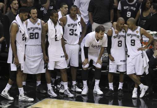 San Antonio Spurs' Tony Parker and Patty Mills share a moment toward the end of Game 5 against the Miami Heat as the Spurs defeat the Heat in the 2014 NBA Finals at the AT&T Center on Sunday, June 15, 2014. (Kin Man Hui/San Antonio Express-News) Photo: Kin Man Hui, San Antonio Express-News