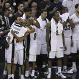 San Antonio Spurs' Manu Ginobili, Tony Parker, Tim Duncan and Patty Mills joins the rest of the team in celebrating their eventual victory over the Miami Heat in Game 5 of the 2014 NBA Finals at the AT&T Center on Sunday, June 15, 2014. (Kin Man Hui/San Antonio Express-News)