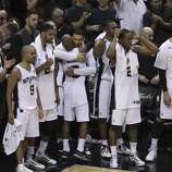 San Antonio Spurs' rejoice in the closing moments of Game 5 against the Miami Heat as the Spurs eventually win the 2014 NBA Finals at the AT&T Center on Sunday, June 15, 2014. (Kin Man Hui/San Antonio Express-News)