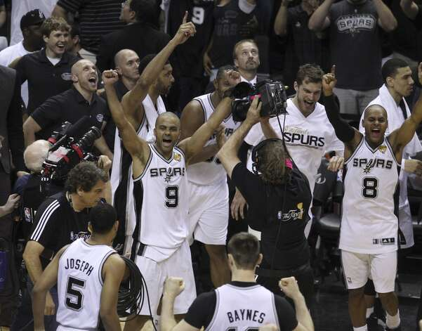 San Antonio Spurs celebrate their final moments of Game 5 against the Miami Heat in the 2014 NBA Finals at the AT&T Center on Sunday, June 15, 2014. (Kin Man Hui/San Antonio Express-News) Photo: Kin Man Hui, San Antonio Express-News