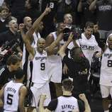 San Antonio Spurs celebrate their final moments of Game 5 against the Miami Heat in the 2014 NBA Finals at the AT&T Center on Sunday, June 15, 2014. (Kin Man Hui/San Antonio Express-News)