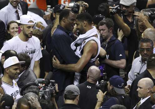 San Antonio Spurs' Tim Duncan and David Robinson share a moment after the Spurs defeat the Miami Heat in Game 5 of the 2014 NBA Finals at the AT&T Center on Sunday, June 15, 2014. (Kin Man Hui/San Antonio Express-News) Photo: Kin Man Hui, San Antonio Express-News