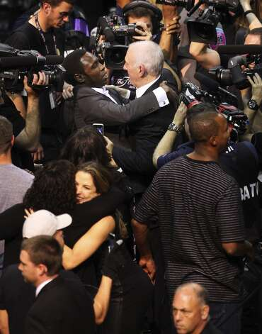 San Antonio Spurs coach Gregg Popovich receives congratulations from former Spurs Avery Johnson after the Spurs defeat the Miami Heat in Game 5 of the 2014 NBA Finals at the AT&T Center on Sunday, June 15, 2014. (Kin Man Hui/San Antonio Express-News) Photo: Kin Man Hui, San Antonio Express-News