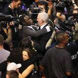 San Antonio Spurs coach Gregg Popovich receives congratulations from former Spurs Avery Johnson after the Spurs defeat the Miami Heat in Game 5 of the 2014 NBA Finals at the AT&T Center on Sunday, June 15, 2014. (Kin Man Hui/San Antonio Express-News)