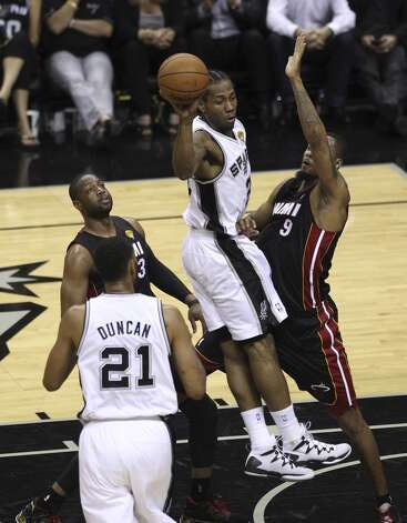 San Antonio Spurs' Kawhi Leonard drives the paint on Miami Heat's Rashard Lewis in the first quarter of Game 5 of the 2014 NBA Finals at the AT&T Center on Sunday, June 15, 2014. (Kin Man Hui/San Antonio Express-News) Photo: Kin Man Hui, San Antonio Express-News