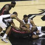 San Antonio Spurs' Tim Duncan and Kawhi Leonard battle Miami Heat's Chris Bosh for a loose ball in the first quarter of Game 5 of the 2014 NBA Finals at the AT&T Center on Sunday, June 15, 2014. (Kin Man Hui/San Antonio Express-News)