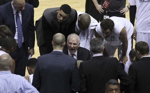San Antonio Spurs head coach Gregg Popovich talks the to team during a timeout in the first quarter of Game 5 of the 2014 NBA Finals at the AT&T Center on Sunday, June 15, 2014. (Kin Man Hui/San Antonio Express-News) Photo: Kin Man Hui, San Antonio Express-News