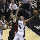 San Antonio Spurs' Tony Parker drives on Miami Heat's Chris Andersen in Game 5 of the 2014 NBA Finals at the AT&T Center on Sunday, June 15, 2014. (Kin Man Hui/San Antonio Express-News)