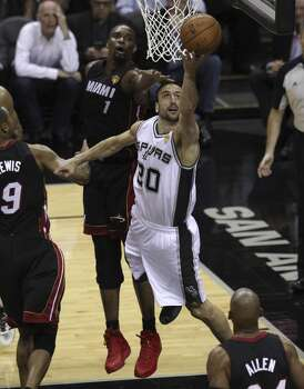 San Antonio Spurs' Manu Ginobili drives on a shot Miami Heat's Chris Bosh in Game 5 of the 2014 NBA Finals at the AT&T Center on Sunday, June 15, 2014. (Kin Man Hui/San Antonio Express-News) Photo: Kin Man Hui, San Antonio Express-News