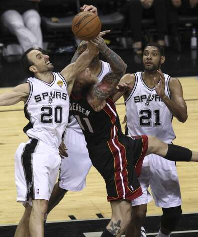 San Antonio Spurs' Manu Ginobili and Tim Duncan defend against Miami Heat's Chris Andersen in Game 5 of the 2014 NBA Finals at the AT&T Center on Sunday, June 15, 2014. (Kin Man Hui/San Antonio Express-News) Photo: San Antonio Express-News