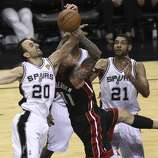 San Antonio Spurs' Manu Ginobili and Tim Duncan defend against Miami Heat's Chris Andersen in Game 5 of the 2014 NBA Finals at the AT&T Center on Sunday, June 15, 2014. (Kin Man Hui/San Antonio Express-News)