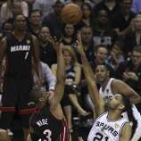 San Antonio Spurs' Tim Duncan attempts to block a shot by Miami Heat's Dwyane Wade in Game 5 of the 2014 NBA Finals at the AT&T Center on Sunday, June 15, 2014. (Kin Man Hui/San Antonio Express-News)