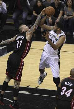 San Antonio Spurs' Tim Duncan gets fouled by Miami Heat's Chris Andersen in Game 5 of the 2014 NBA Finals at the AT&T Center on Sunday, June 15, 2014. (Kin Man Hui/San Antonio Express-News) Photo: San Antonio Express-News