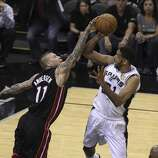 San Antonio Spurs' Tim Duncan gets fouled by Miami Heat's Chris Andersen in Game 5 of the 2014 NBA Finals at the AT&T Center on Sunday, June 15, 2014. (Kin Man Hui/San Antonio Express-News)