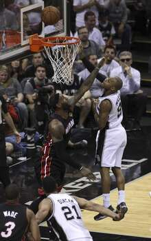 San Antonio Spurs' Patty Mills takes a shot against Miami Heat's LeBron James in Game 5 of the 2014 NBA Finals at the AT&T Center on Sunday, June 15, 2014. (Kin Man Hui/San Antonio Express-News) Photo: San Antonio Express-News