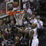San Antonio Spurs' Patty Mills takes a shot against Miami Heat's LeBron James in Game 5 of the 2014 NBA Finals at the AT&T Center on Sunday, June 15, 2014. (Kin Man Hui/San Antonio Express-News)