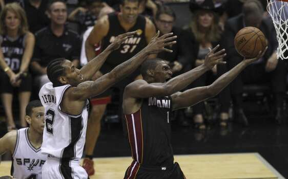 San Antonio Spurs' Kawhi Leonard attempts to defend Miami Heat's Chris Bosh in Game 5 of the 2014 NBA Finals at the AT&T Center on Sunday, June 15, 2014. (Kin Man Hui/San Antonio Express-News) Photo: San Antonio Express-News
