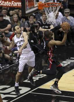 San Antonio Spurs' Manu Ginobili tries to swat a shot by Miami Heat's Dwyane Wade in the second quarter of Game 5 of the 2014 NBA Finals at the AT&T Center on Sunday, June 15, 2014. (Kin Man Hui/San Antonio Express-News) Photo: San Antonio Express-News