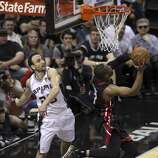 San Antonio Spurs' Manu Ginobili tries to swat a shot by Miami Heat's Dwyane Wade in the second quarter of Game 5 of the 2014 NBA Finals at the AT&T Center on Sunday, June 15, 2014. (Kin Man Hui/San Antonio Express-News)