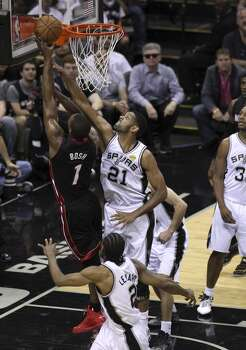 San Antonio Spurs' Tim Duncan goes to block the shot of Miami Heat's Chris Bosh in the second quarter of Game 5 of the 2014 NBA Finals at the AT&T Center on Sunday, June 15, 2014. (Kin Man Hui/San Antonio Express-News) Photo: San Antonio Express-News