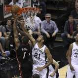 San Antonio Spurs' Tim Duncan goes to block the shot of Miami Heat's Chris Bosh in the second quarter of Game 5 of the 2014 NBA Finals at the AT&T Center on Sunday, June 15, 2014. (Kin Man Hui/San Antonio Express-News)
