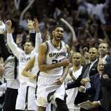 San Antonio Spurs' Tim Duncan celebrates with the bench during second half action in Game 5 of the 2014 NBA Finals Sunday June 15, 2014 at the AT&T Center.
