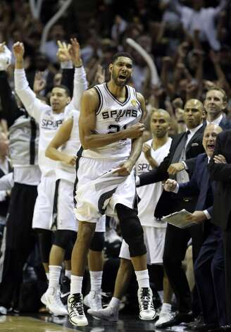 San Antonio Spurs' Tim Duncan celebrates with the bench during second half action in Game 5 of the 2014 NBA Finals Sunday June 15, 2014 at the AT&T Center. Photo: San Antonio Express-News