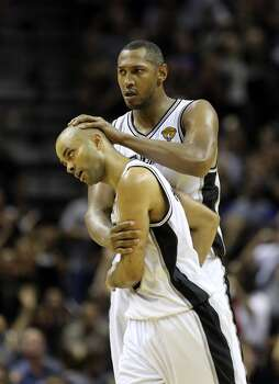 San Antonio Spurs' Boris Diaw celebrates with San Antonio Spurs' Tony Parker  during second half action in Game 5 of the 2014 NBA Finals Sunday June 15, 2014 at the AT&T Center. Photo: San Antonio Express-News