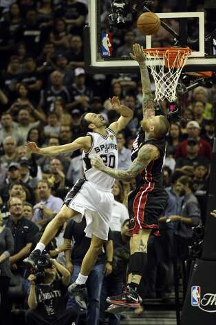 San Antonio Spurs' Manu Ginobili scores over Miami Heat's Chris Andersen during fourth quarter action in Game 5 of the 2014 NBA Finals Sunday June 15, 2014 at the AT&T Center. Photo: San Antonio Express-News