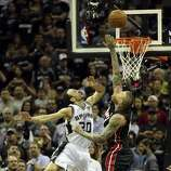 San Antonio Spurs' Manu Ginobili scores over Miami Heat's Chris Andersen during fourth quarter action in Game 5 of the 2014 NBA Finals Sunday June 15, 2014 at the AT&T Center.