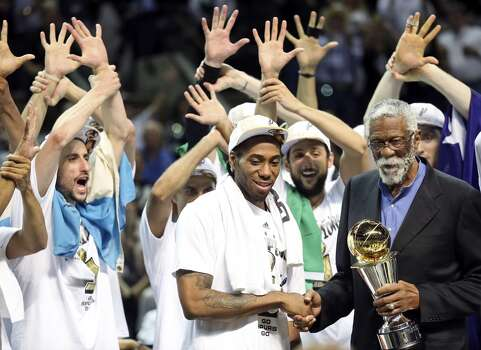 San Antonio Spurs' Kawhi Leonard is presented the MVP trophy from Bill Russell after Game 5 of the 2014 NBA Finals against the Miami Heat Sunday June 15, 2014 at the AT&T Center. The Spurs won 104-87. Photo: San Antonio Express-News