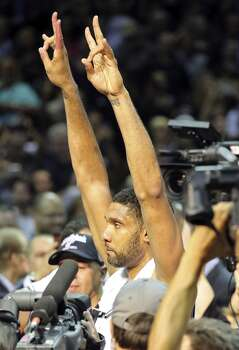 San Antonio Spurs' Tim Duncan celebrates after Game 5 of the 2014 NBA Finals against the Miami Heat Sunday June 15, 2014 at the AT&T Center. The Spurs won 104-87. Photo: San Antonio Express-News