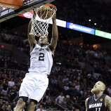 San Antonio Spurs' Kawhi Leonard goes up for a dunk around Miami Heat's Chris Andersen during first half action in Game 5 of the 2014 NBA Finals Sunday June 15, 2014 at the AT&T Center.