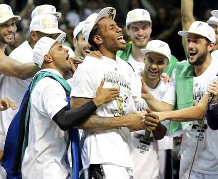 San Antonio Spurs' Kawhi Leonard celebrates with teammates react after Game 5 of the 2014 NBA Finals against the Miami Heat Sunday June 15, 2014 at the AT&T Center. The Spurs won 104-87. Leonard was MVP of the game. Photo: San Antonio Express-News
