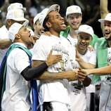 San Antonio Spurs' Kawhi Leonard celebrates with teammates react after Game 5 of the 2014 NBA Finals against the Miami Heat Sunday June 15, 2014 at the AT&T Center. The Spurs won 104-87. Leonard was MVP of the game.
