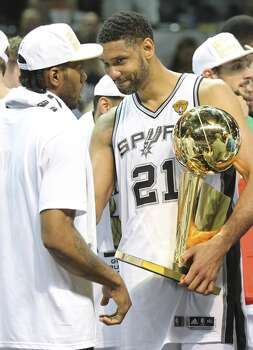 San Antonio Spurs' Kawhi Leonard (left) and San Antonio Spurs' Tim Duncan talk after Game 5 of the 2014 NBA Finals against the Miami Heat Sunday June 15, 2014 at the AT&T Center. The Spurs won 104-87. Photo: San Antonio Express-News