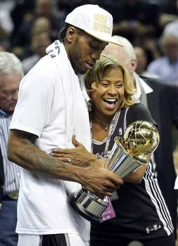 San Antonio Spurs' Kawhi Leonard hugs his mother Kim Robertson after Game 5 of the 2014 NBA Finals against the Miami Heat Sunday June 15, 2014 at the AT&T Center. The Spurs won 104-87. Photo: San Antonio Express-News