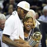 San Antonio Spurs' Kawhi Leonard hugs his mother Kim Robertson after Game 5 of the 2014 NBA Finals against the Miami Heat Sunday June 15, 2014 at the AT&T Center. The Spurs won 104-87.