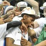 San Antonio Spurs' Kawhi Leonard celebrates with teammates after Game 5 of the 2014 NBA Finals against the Miami Heat Sunday June 15, 2014 at the AT&T Center. The Spurs won 104-87. Leonard was MVP of the game.