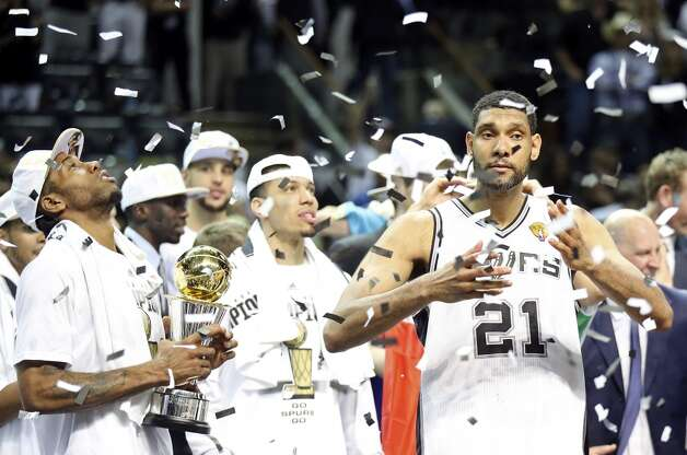 San Antonio Spurs' Kawhi Leonard, Tim Duncan and teammates react after Game 5 of the 2014 NBA Finals against the Miami Heat Sunday June 15, 2014 at the AT&T Center. The Spurs won 104-87. Photo: San Antonio Express-News