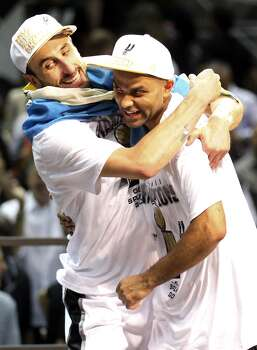 San Antonio Spurs' Manu Ginobili and Tony Parker celebrate after Game 5 of the 2014 NBA Finals against the Miami Heat Sunday June 15, 2014 at the AT&T Center. The Spurs won 104-87. Photo: San Antonio Express-News