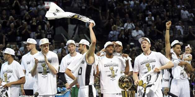 San Antonio Spurs' Manu Ginobili (center) and teammates celebrate after Game 5 of the 2014 NBA Finals against the Miami Heat Sunday June 15, 2014 at the AT&T Center. The Spurs won 104-87. Photo: San Antonio Express-News