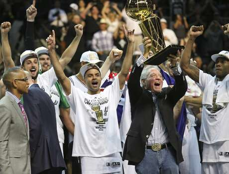 San Antonio Spurs' Marco Belinelli, Tony Parker, Peter Holt, Kawhi Leonard and others celebrate after defeating the Miami Heat in Game 5 of the 2014 NBA Finals Sunday June 15, 2014 at the AT&T Center. The Spurs won 104-87. Photo: San Antonio Express-News
