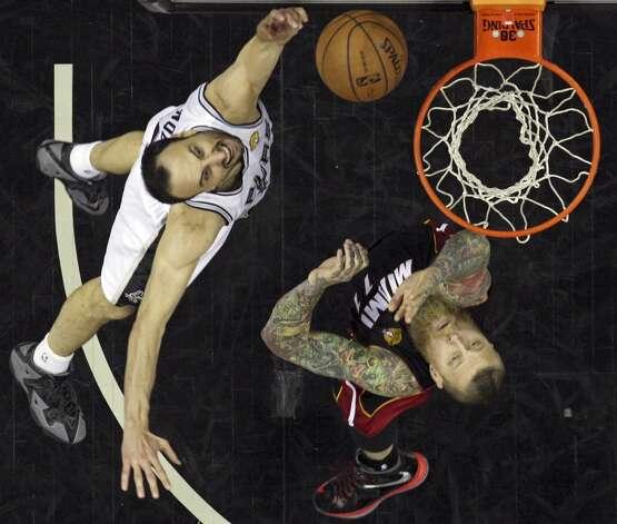 San Antonio Spurs' Manu Ginobili shoots around Miami Heat's Chris Andersen in Game 5 of the 2014 NBA Finals Sunday June 15, 2014 at the AT&T Center. The Spurs won 104-87. Photo: San Antonio Express-News