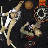 San Antonio Spurs' Manu Ginobili shoots around Miami Heat's Chris Andersen in Game 5 of the 2014 NBA Finals Sunday June 15, 2014 at the AT&T Center. The Spurs won 104-87.